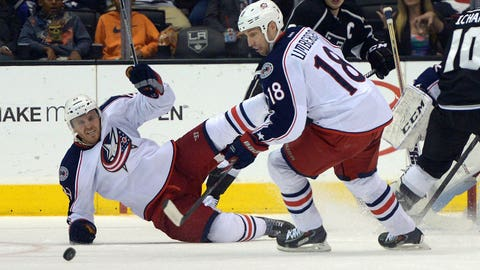Feb 6, 2014; Los Angeles, CA, USA; Columbus Blue Jackets defenseman James Wisniewski (21) and left wing R.J. Umberger (21) pursue the puck in the second period against the Los Angeles Kings at Staples Center. Mandatory Credit: Kirby Lee-USA TODAY Sports