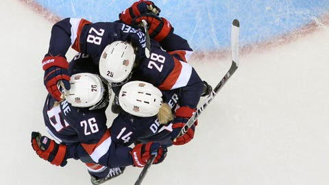 (From L) US' Kendall Coyne, Amanda Kessel and Brianna Decker celebrate after a goal during the Women's Ice Hockey Group A match USA vs Switzerland at the Shayba Arena during the Sochi Winter Olympics on February 10, 2014.  AFP PHOTO / JONATHAN NACKSTRAND        (Photo credit should read JONATHAN NACKSTRAND/AFP/Getty Images)