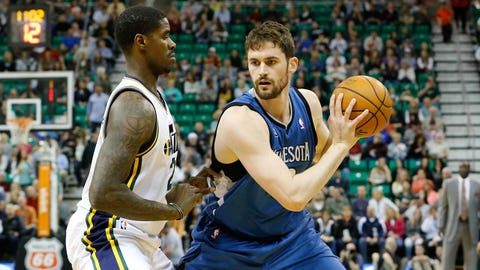Feb 22, 2014; Salt Lake City, UT, USA; Minnesota Timberwolves power forward Kevin Love (42) controls the ball against Utah Jazz power forward Marvin Williams (2) during the first quarter at EnergySolutions Arena. Mandatory Credit: Chris Nicoll-USA TODAY Sports