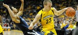 Thomas helps Marquette push past Xavier