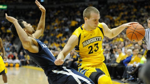Feb 15, 2014; Milwaukee, WI, USA;   Marquette Golden Eagles guard Jake Thomas (23) drives past Xavier Musketeers guard Dee Davis (11) in the 1st quarter at BMO Harris Bradley Center. Mandatory Credit: Benny Sieu-USA TODAY Sports
