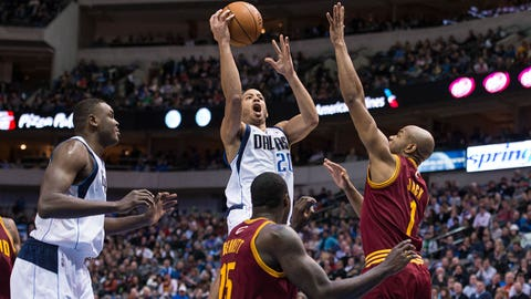 Feb 3, 2014; Dallas, TX, USA; Dallas Mavericks point guard Devin Harris (20) shoots over Cleveland Cavaliers small forward Anthony Bennett (15) and point guard Jarrett Jack (1) during the first half at American Airlines Center. Mandatory Credit: Jerome Miron-USA TODAY Sports