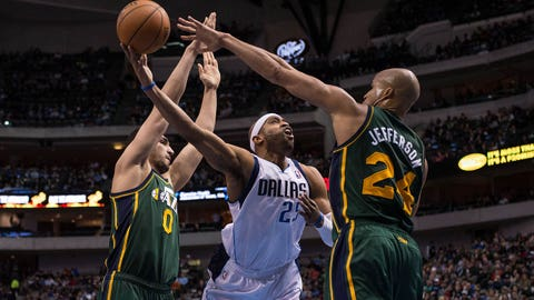 Feb 7, 2014; Dallas, TX, USA; Dallas Mavericks shooting guard Vince Carter (25) shoots the ball as Utah Jazz center Enes Kanter (0) and small forward Richard Jefferson (24) defend during the second half at American Airlines Center. The Mavericks defeated the Jazz 103-81. Mandatory Credit: Jerome Miron-USA TODAY Sports
