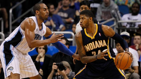 Feb 9, 2014; Orlando, FL, USA; Indiana Pacers small forward Paul George (24) drives to the basket as Orlando Magic shooting guard Arron Afflalo (4) defends during the first quarter at Amway Center. Mandatory Credit: Kim Klement-USA TODAY Sports