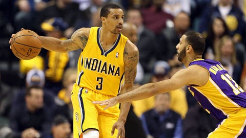 Feb 25, 2014; Indianapolis, IN, USA; Indiana Pacers guard George Hill (3) is guarded by Los Angeles Lakers guard Kendall Marshall (12) at Bankers Life Fieldhouse. Mandatory Credit: Brian Spurlock-USA TODAY Sports