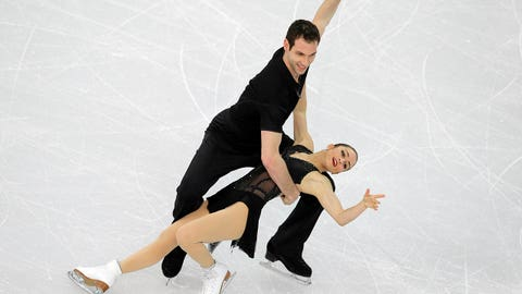 Marissa Castelli and Simon Shnapir of the United States compete in the team pairs short program figure skating competition at the Iceberg Skating Palace during the 2014 Winter Olympics, Thursday, Feb. 6, 2014, in Sochi, Russia. (AP Photo/Vadim Ghirda)