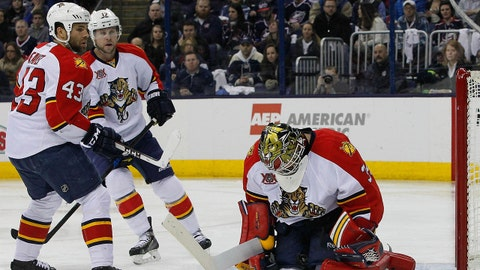 Feb 1, 2014; Columbus, OH, USA; Florida Panthers goalie Tim Thomas (30) makes a save against the Columbus Blue Jackets during the second period at Nationwide Arena. Mandatory Credit: Russell LaBounty-USA TODAY Sports