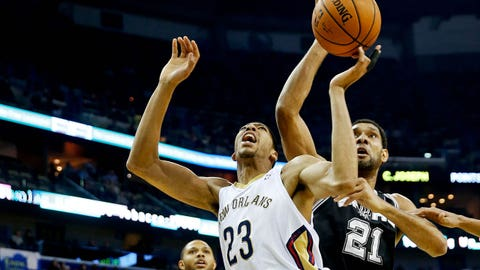 Feb 3, 2014; New Orleans, LA, USA; New Orleans Pelicans power forward Anthony Davis (23) and San Antonio Spurs power forward Tim Duncan (21) battle for a rebound during the first quarter of a game at the New Orleans Arena. Mandatory Credit: Derick E. Hingle-USA TODAY Sports