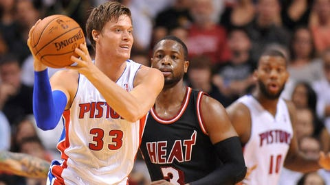 Feb 3, 2014; Miami, FL, USA; Detroit Pistons power forward Jonas Jerebko (33) is pressured by Miami Heat shooting guard Dwyane Wade (3) during the second half at American Airlines Arena. Mandatory Credit: Steve Mitchell-USA TODAY Sports