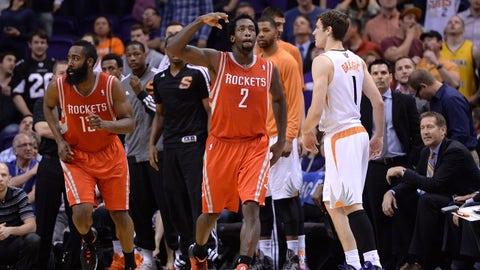 Feb 23, 2014; Phoenix, AZ, USA; Houston Rockets point guard Patrick Beverley (2) celebrates his go ahead three point shot late in the second half over Phoenix Suns shooting guard Goran Dragic (1) at US Airways Center. Mandatory Credit: Joe Camporeale-USA TODAY Sports