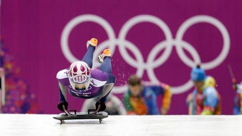 Noelle Pikus-Pace of the United States starts a training run for the women's skeleton during the 2014 Winter Olympics, Monday, Feb. 10, 2014, in Krasnaya Polyana, Russia. (AP Photo/Natacha Pisarenko)
