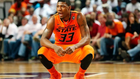 Jan 27, 2014; Norman, OK, USA; Oklahoma State Cowboys guard Marcus Smart (33) reacts during the game against the Oklahoma Sooners at Lloyd Noble Center. Oklahoma won 88-76. Mandatory Credit: Kevin Jairaj-USA TODAY Sports