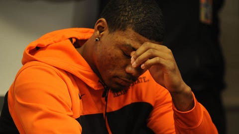Feb 9, 2014; Stillwater , OK, USA; Oklahoma State Cowboys guard Marcus Smart listens as head coach Travis Ford (not pictured) address the media at Gallagher-Iba Arena. Mandatory Credit: Mark D. Smith-USA TODAY Sports