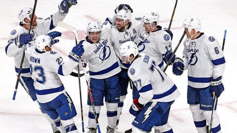 Feb 1, 2014; Montreal, Quebec, CAN; Tampa Bay Lightning celebrate their win against Montreal Canadiens after an over time period at Bell Centre. Mandatory Credit: Jean-Yves Ahern-USA TODAY Sports