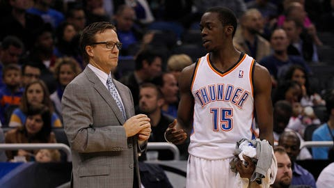 Feb 7, 2014; Orlando, FL, USA; Oklahoma City Thunder head coach Scott Brooks talks to point guard Reggie Jackson (15) against the Orlando Magich during the first half at Amway Center. Mandatory Credit: Kim Klement-USA TODAY Sports