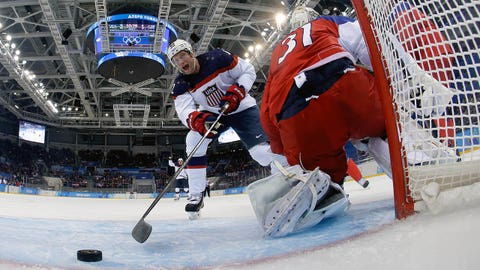 SOCHI, - - FEBRUARY 19:  David Backes #42 of the United States scores his team's third goal in the first period against Ondrej Pavelec #31 of the Czech Republic during the Men's Ice Hockey Quarterfinal Playoff on Day 12 of the 2014 Sochi Winter Olympics at Shayba Arena on February 19, 2014 in Sochi, Russia.  (Photo by Pool/Getty Images)