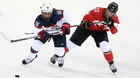 SOCHI, RUSSIA - FEBRUARY 12: Kelli Stack of USA and Hayley Wickenheiser of Canada in action during the Women's Ice Hockey Preliminary Round Group A game between USA and Canada on day 5 of the Sochi 2014 Winter Olympics at Shayba Arena on February 12, 2014 in Sochi, Russia. (Photo by John Berry/Getty Images)