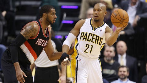 Feb 7, 2014; Indianapolis, IN, USA; Indiana Pacers forward David West (21) is guarded by Portland Trail Blazers forward LaMarcus Aldridge (12) at Bankers Life Fieldhouse. Mandatory Credit: Brian Spurlock-USA TODAY Sports