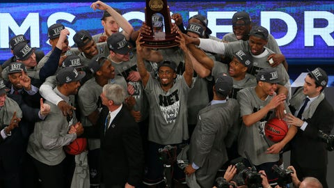 oMar 30, 2014; New York, NY, USA; The Connecticut Huskies celebrate with the trophy after beating the Michigan State Spartans in the finals of the east regional of the 2014 NCAA Mens Basketball Championship tournament at Madison Square Garden. Mandatory Credit: Adam Hunger-USA TODAY Sports