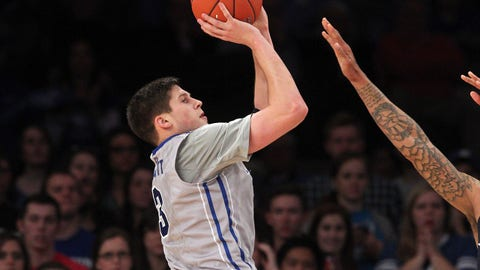 Mar 14, 2014; New York, NY, USA; Creighton Bluejays forward Doug McDermott (3) shoots over Xavier Musketeers forward Justin Martin (20) during the second half of a semifinal game of the Big East college basketball tournament at Madison Square Garden. Creighton defeated Xavier 86-78. Mandatory Credit: Brad Penner-USA TODAY Sports