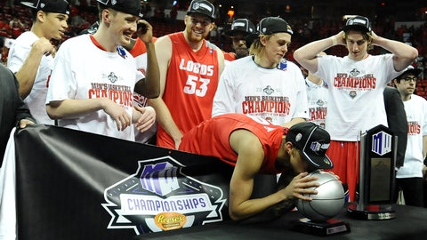 Mar 15, 2014; Las Vegas, NV, USA; New Mexico Lobos guard Kendall Williams (10) kisses the MVP trophy following the win against the San Diego State Aztecs of the championship game for the Mountain West Conference college basketball tournament at Thomas and Mack Center. The Lobos defeated the Aztecs 64-58. Mandatory Credit: Ron Chenoy-USA TODAY Sports