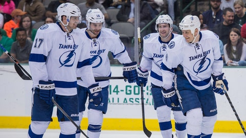 Mar 1, 2014; Dallas, TX, USA; Tampa Bay Lightning center Alex Killorn (17) and right wing Teddy Purcell (16) and center Tom Pyatt (11) and defenseman Sami Salo (6) celebrate Salos goal against the Dallas Stars during the third period at the American Airlines Center. The Lightning defeated the Stars 4-2. Mandatory Credit: Jerome Miron-USA TODAY Sports