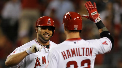 May 14, 2013; Anaheim, CA, USA; Los Angeles Angels first baseman Albert Pujols (5) celebrates with Los Angeles Angels designated hitter Josh Hamilton (32) after hitting a home run against the Kansas City Royals during the fourth inning at Angel Stadium of Anaheim. Mandatory Credit: Kelvin Kuo-USA TODAY Sports
