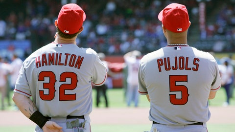 Apr 5, 2013; Arlington, TX, USA; Los Angeles Angels right fielder Josh Hamilton (32) and first baseman Albert Pujols (5) on the field before the game against the Texas Rangers at Rangers Ballpark in Arlington. Mandatory Credit: Tim Heitman-USA TODAY Sports