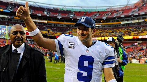 Dec 8, 2013; Landover, MD, USA; Dallas Cowboys quarterback Tony Romo (9) walks off the field after defeating the Washington Redskins at FedEx Field. Mandatory Credit: Brad Mills-USA TODAY Sports