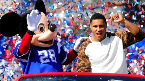 Feb 3, 2014; Orlando, FL, USA; Super Bowl XLVIII Malcolm Smith, linebacker for the Seattle Seahawks, waves to the crowd during a parade with Mickey Mouse at the Walt Disney World Resort.  Mandatory Credit: David Manning-USA TODAY Sports