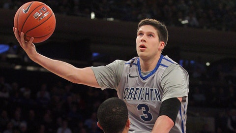 Mar 13, 2014; New York, NY, USA; Creighton Bluejays forward Doug McDermott (3) drives on DePaul Blue Demons guard Billy Garrett Jr. (5) during the first half of a game in the second round of the Big East college basketball tournament at Madison Square Garden. Mandatory Credit: Brad Penner-USA TODAY Sports
