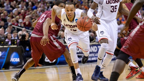 Mar 20, 2014; Buffalo, NY, USA; Connecticut Huskies guard Shabazz Napier (13) drives to the basket against Saint Joseph's Hawks in overtime of a men's college basketball game during the second round of the 2014 NCAA Tournament at First Niagara Center. Mandatory Credit: Mark Konezny-USA TODAY Sports