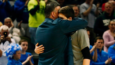 Mar 23, 2014; San Antonio, TX, USA; Creighton Bluejays head coach Greg McDermott embraces forward Doug McDermott (3) after they lost to the Baylor Bears in a men's college basketball game during the third round of the 2014 NCAA Tournament at AT&T Center. Mandatory Credit: Kevin Jairaj-USA TODAY Sports