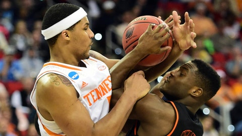 Mar 23, 2014; Raleigh, NC, USA; Mercer Bears guard Ike Nwamu (10) shoots the ball against Tennessee Volunteers forward Jarnell Stokes (5) during the second half of a men's college basketball game during the third round of the 2014 NCAA Tournament at PNC Arena. Mandatory Credit: Bob Donnan-USA TODAY Sports