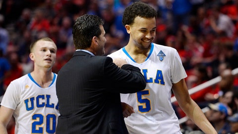 Mar 23, 2014; San Diego, CA, USA; UCLA Bruins head coach Steve Alford welcomes Kyle Anderson (5) and Bryce Alford (20) back to the bench in the second half of a men's college basketball game during the third round of the 2014 NCAA Tournament against the Stephen F. Austin Lumberjacks at Viejas Arena. Mandatory Credit: Christopher Hanewinckel-USA TODAY Sports