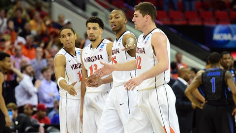 Mar 23, 2014; Raleigh, NC, USA; Virginia Cavaliers guard Malcolm Brogdon (15), forward Anthony Gill (13), forward Akil Mitchell (25) and guard Joe Harris (12) celebrate against the Memphis Tigers during the second half of a men's college basketball game during the third round of the 2014 NCAA Tournament at PNC Arena. Mandatory Credit: Bob Donnan-USA TODAY Sports
