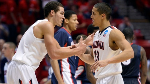 Mar 23, 2014; San Diego, CA, USA; Arizona Wildcats forward Aaron Gordon (left) celebrates with guard Nick Johnson (right) in the second half of a men's college basketball game during the third round of the 2014 NCAA Tournament against the Gonzaga Bulldogs at Viejas Arena. Mandatory Credit: Robert Hanashiro-USA TODAY Sports