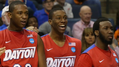 Mar 27, 2014; Memphis, TN, USA; Dayton Flyers forward Kendall Pollard (22), Jordan Sibert (24), Khari Price (0) and assistant coach Allen Griffin cheer on the bench against the Stanford Cardinal during the second half in the semifinals of the south regional of the 2014 NCAA Mens Basketball Championship tournament at FedExForum. Mandatory Credit: Nelson Chenault-USA TODAY Sports