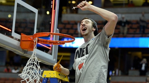 Mar 29, 2014; Anaheim, CA, USA; Wisconsin Badgers forward Frank Kaminsky (44) celebrates cutting the net after overtime in the finals of the west regional of the 2014 NCAA Mens Basketball Championship tournament against the Arizona Wildcatsat Honda Center. The Badgers defeated the Wildcats 64-63. Mandatory Credit: Richard Mackson-USA TODAY Sports