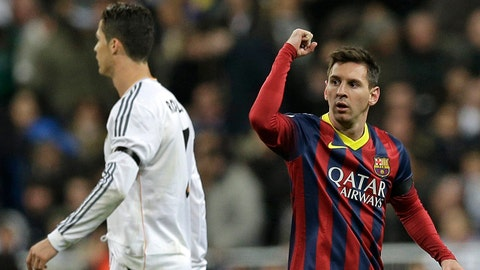 FC Barcelona's Lionel Messi from Argentina, right celebrates next to Real Madrid's Cristiano Ronaldo after scoring his team's 2nd goal during a Spanish La Liga soccer match at the Santiago Bernabeu stadium in Madrid, Sunday March 23, 2014. (AP Photo/Paul White)