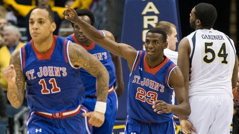 St. Johns' Rysheed Jordan (23) and teammates react to their 91-90 win iin double overtime over Marquette in an NCAA college basketball game Saturday, March 8, 2014, in Milwaukee.  (AP Photo/Tom Lynn)