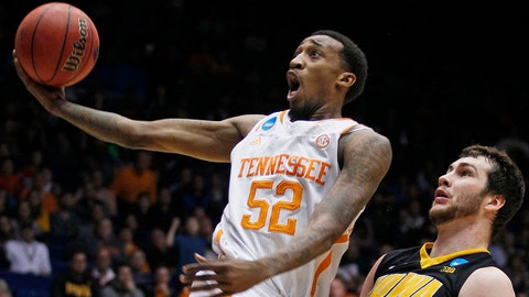 Tennessee guard Jordan McRae (52) drives against Iowa forward Zach McCabe (15) in overtime of a first-round game of the NCAA college basketball tournament, Wednesday, March 19, 2014, in Dayton, Ohio. McRae led Tennessee to a 78-65 win with 20 points. (AP Photo/Skip Peterson)