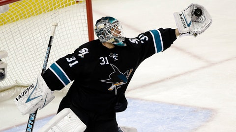 San Jose Sharks goalie Antti Niemi, of Finland, stops a shot by the Anaheim Ducks during the third period of an NHL hockey game Thursday, March 20, 2014, in San Jose, Calif. San Jose won 3-2. (AP Photo/Marcio Jose Sanchez)