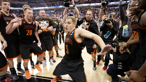 Mercer guard Kevin Canevari (3) dances with team mates after the second half of an NCAA college basketball second-round game against Duke, Friday, March 21, 2014, in Raleigh, N.C. Mercer won 78-71. (AP Photo/Chuck Burton)