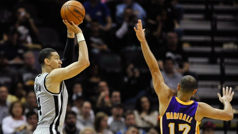 San Antonio Spurs guard Danny Green shoots a 3-pointer against Los Angeles Lakers guard Kendall Marshall in the first half of an NBA basketball game Friday, March 14, 2014 in San Antonio. (AP Photo/Bahram Mark Sobhani)