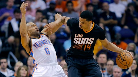 Oklahoma City Thunder guard Derek Fisher (6) is backed down by Phoenix Suns' Gerald Green (14) during the first half of an NBA basketball game, Thursday, March 6, 2014, in Phoenix. (AP Photo/Matt York)
