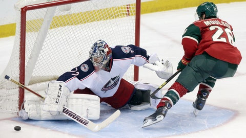 Columbus Blue Jackets goalie Sergei Bobrovsky, left, of Russia, stops a shootout attempt by Minnesota Wild's Matt Moulson in an NHL hockey game, Saturday, March 15, 2014, in St. Paul, Minn. The Blue Jackets won 2-1 in the shootout. (AP Photo/Jim Mone)