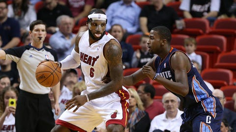 Mar 3, 2014; Miami, FL, USA; Miami Heat small forward LeBron James (6) is defended by Charlotte Bobcats small forward Michael Kidd-Gilchrist (14) in the first half at American Airlines Arena. Mandatory Credit: Robert Mayer-USA TODAY Sports