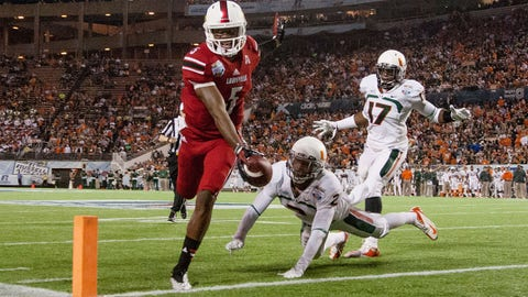 Dec 28, 2013; Orlando, FL, USA; Louisville Cardinals quarterback Teddy Bridgewater (5) rushes into the end zone for a touchdown during the second half of the Russell Athletic Bowl against the Miami Hurricanes at Florida Citrus Bowl Stadium. Mandatory Credit: Rob Foldy-USA TODAY Sports