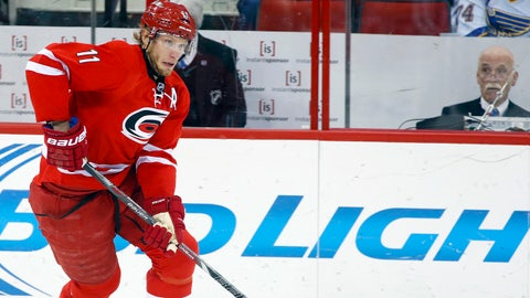 Jan 31, 2014; Raleigh, NC, USA; Carolina Hurricanes forward Eric Staal (12) carries the puck against the St. Louis Blues at PNC Arena. The Carolina Hurricanes defeated the St. Louis Blues 3-1. Mandatory Credit: James Guillory-USA TODAY Sports